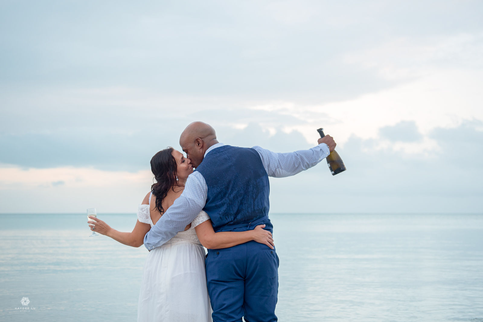 Jill & Dwight's Romantic Elopement Off the Coast of Ambergris Caye, Photography by Haydee Lu Studio for Luxury Destination Wedding network Adriana Wedings